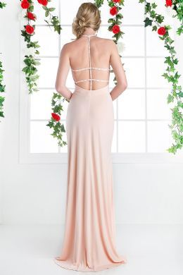 BG2700c in store now.This floor length, sleeveless, high neck, open back dress is on trend. With it's understated beading and thigh high slit it ticks all the boxes!