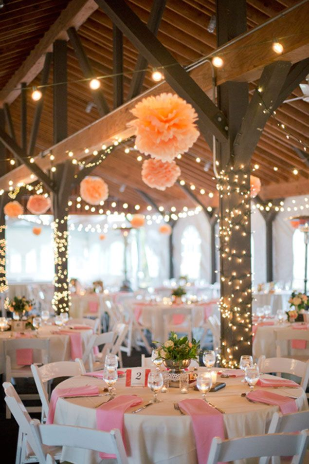 Combine #fairylights & #festoonlights with pom poms  ...♥♥... for a modern twist on a traditional wedding. Wrap the lights around beams and hang the pom poms from the ceiling