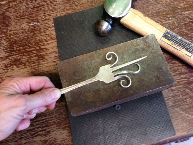 Reuse old forks and turn them into hooks with this easy step by step guide ( https://snapguide.com/guides/make-a-fork-hook/)