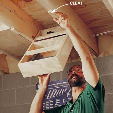Simplify Your Workshop: Eke out every cubic inch of storage in a basement shop with ceiling drawers that hang between the ceiling joists. When a drawer is down, you have easy access to its contents. The drawers are perfect for anything you only need occasionally. When your done, hold the drawers closed with a cleat.       ###do this for xtra (non-woodworking) storage