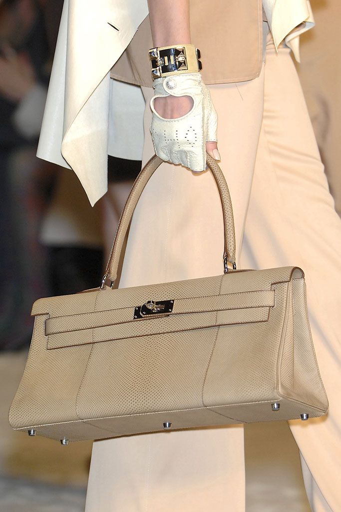 The hell with the fake Hermes bag..where are the gloves!!