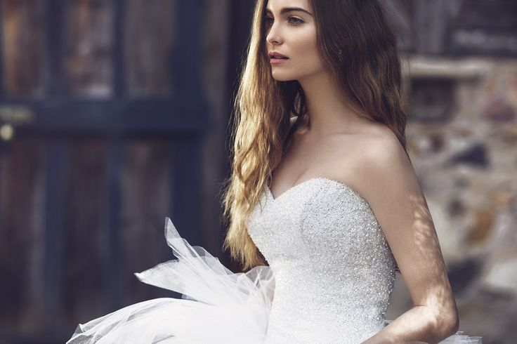 Luv Bridal sweetheart neckline wedding gown. Fully beaded bodice with intricately jeweled detail. #LuvBridal #sweetheart #beadedbodice #wedding #whitedress
