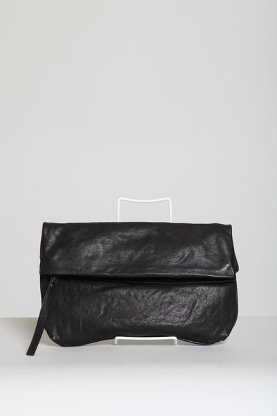 Folded black leather clutch by Yvonne Kone
