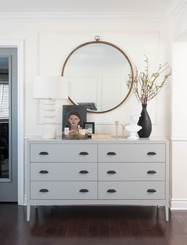 round mirror and grey drawers for the hallway.