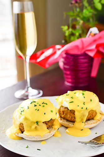 poached eggs nestled on top of crab cakes over slices of homemade english muffins, all drenched in hollandaise sauce.