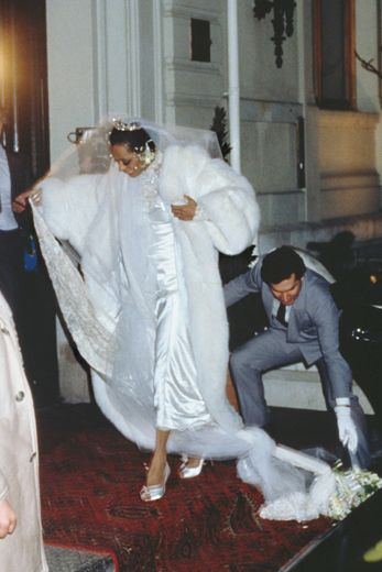BRIDAL FASHION WEEK: CHICEST BRIDES OF ALL TIMES | DIANA ROSS: Leave it to diva Diana Ross to don an epic winter white floor-length fur over a silk gown with lace sleeves, and a cathedral-style veil during her 1985 wedding to Arne Naess Jr. in Switzerland.