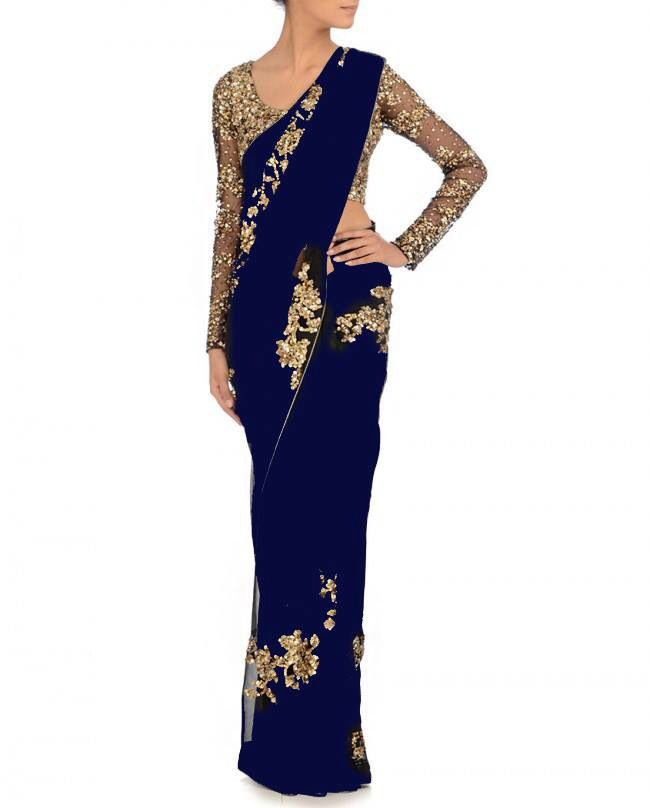 Gorgeous blue and gold sequinned sari! So beautiful, but the blouse needs to be long enough to tuck into the skirt ; )