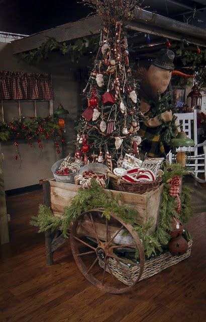 CHRISTMAS TREE~Old Wagon with a prim tree & pine...The Olde Homestead: Our Christmas Shop.
