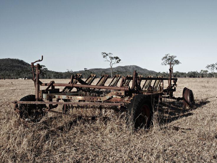 Discarded farm engine in a paddick. Near Bowen, Australia