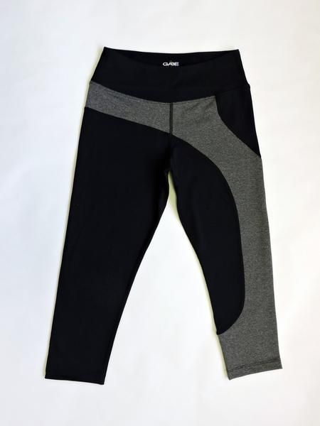 Gabe Clothing's capri leggings are engineered for high performance and movement. The grey contour along one leg creates a unique contrast. Perfect for everyday.  Check out our leggings here: https://www.shopgabeclothing.com/collections/womens/products/capri-leggings