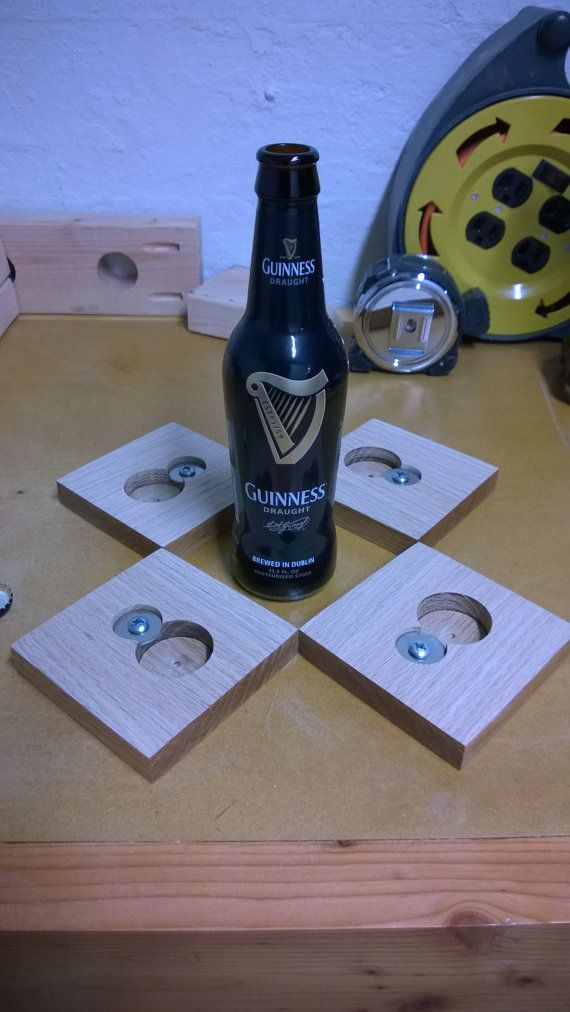 Coaster with a built in bottle opener underneath! Genius!