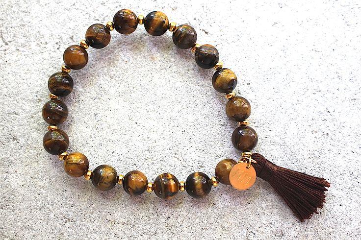 Mala bracelet with 18 gemstones tiger eye and tassel .  Available at minimala.se.