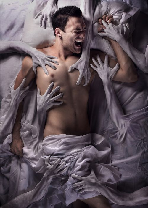 Nightmare man in bed dreaming with hands controlling and tormenting him #fear #photography #dreams