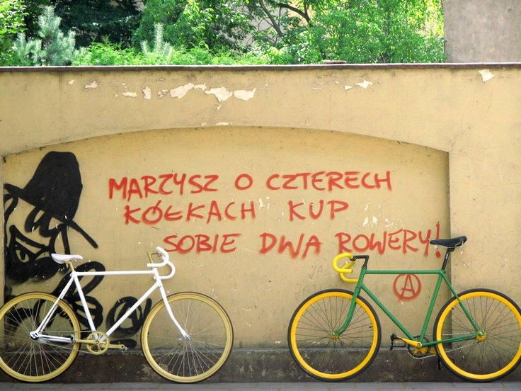 """inscription on the wall (in Polish):     """"if you dream about 'four wheels' buy yourself two bikes!""""     (in Poznan - Jeżyce, the wall of the Old ZOO)"""