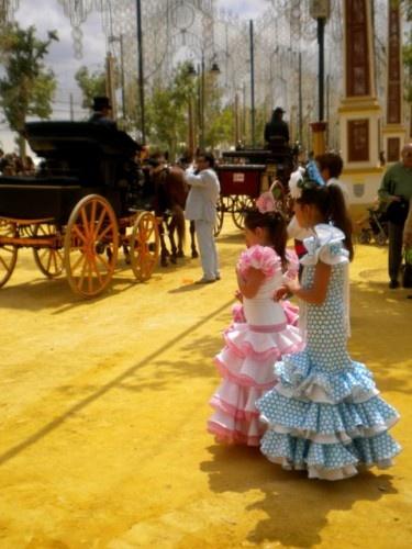 Little girls dressed in 'gitana' dresses for Feria del Caballo in Jerez, Spain