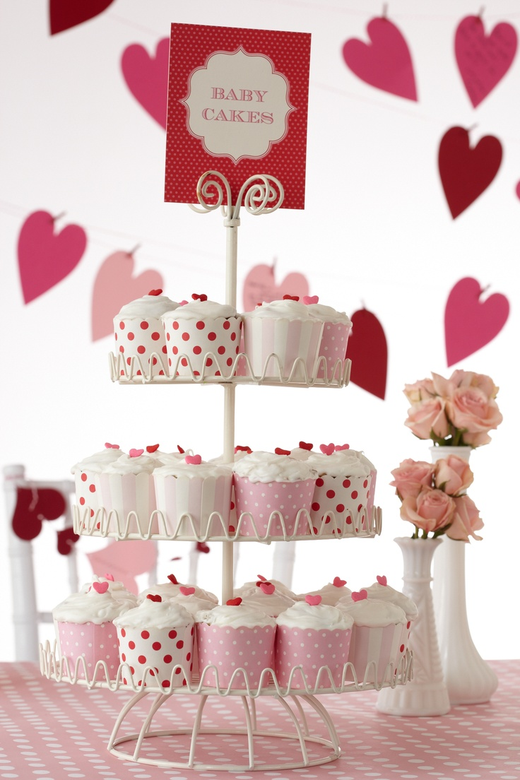 Sweet Baby Cakes. Make a tiered stairway to dessert heaven and carefully place cupcakes where your baby shower guests can enjoy.
