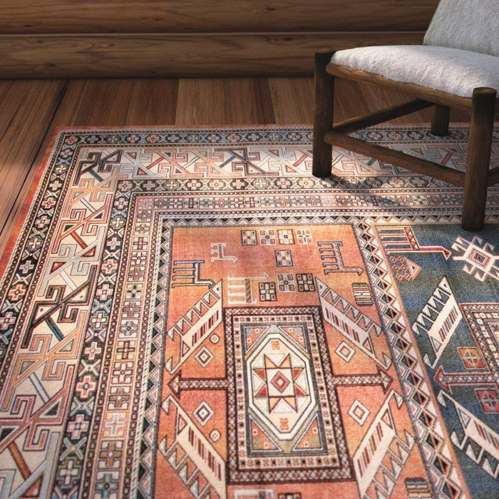 The Ovid Aqua Copper Black And Ivory Area Rug Is Machine Woven