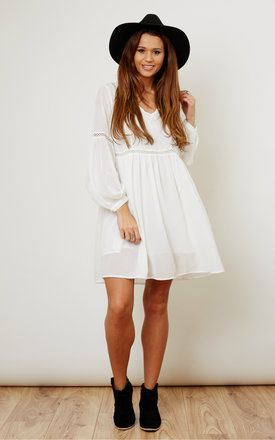 This Boho dress features wide bell sleeves, crochet detailing to the arms and bod