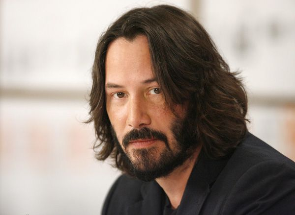 "Actor Keanu Reeves listens during the news conference for the film ""The Private Lives of Pippa Lee"" at the 34th Toronto International Film Festival in Toronto September 15, 2009."