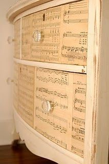 mod podge sheet music dresser.  I like this, but I would try to make the break between the pages less obvious.  Maybe a pic of a flower or plant to hide the lines.