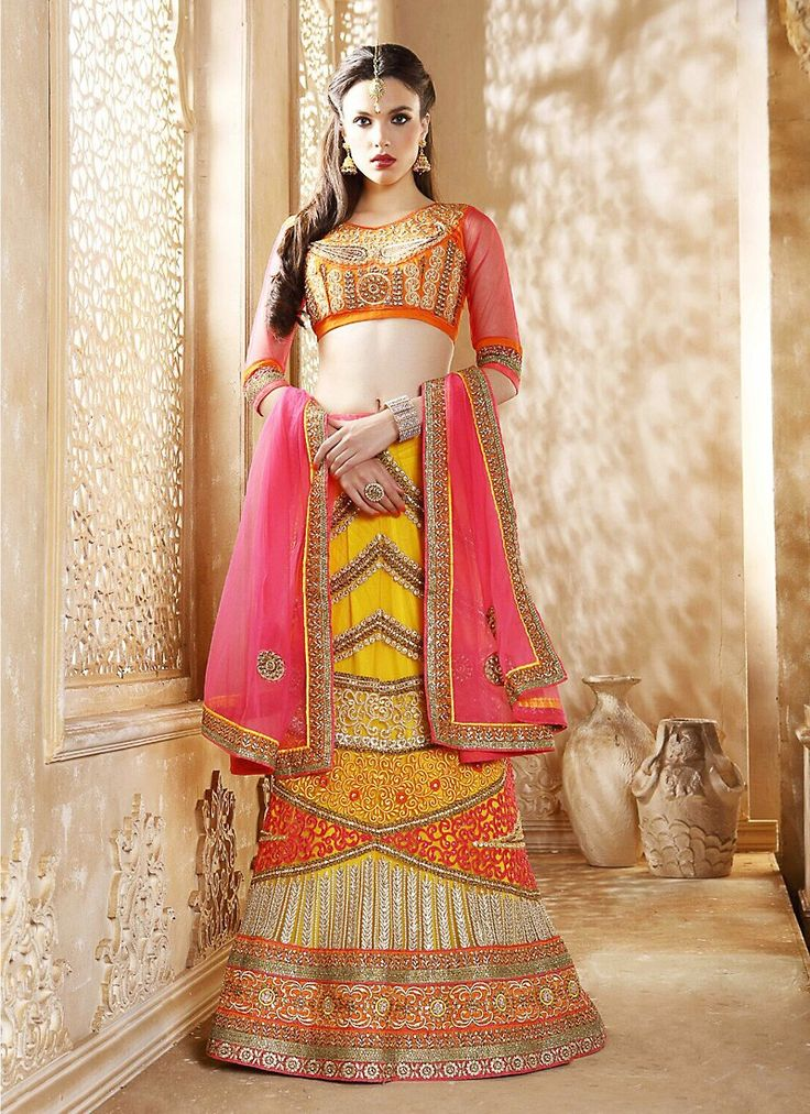Women's Yellow Net Fabric Attractive Unstitched Lehenga Choli In Traditional Look This attire is nicely made with Resham & Butta Work work.