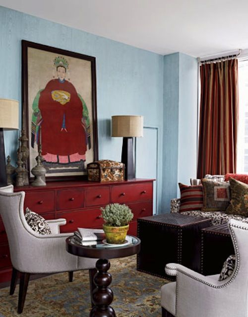 Red dresser, light blue wall and gray.