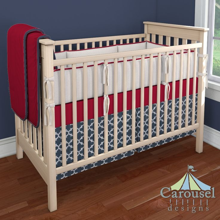 Crib bedding in Cream Matelesse, Solid Red, Solid Navy, Navy Quatrefoil. Created using the Nursery Designer® by Carousel Designs where you mix and match from hundreds of fabrics to create your own unique baby bedding. #carouseldesigns