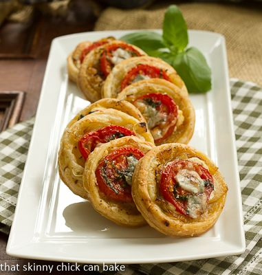 Puff pastry rounds topped with caramelized onions, tomatoes and Boursin cheese