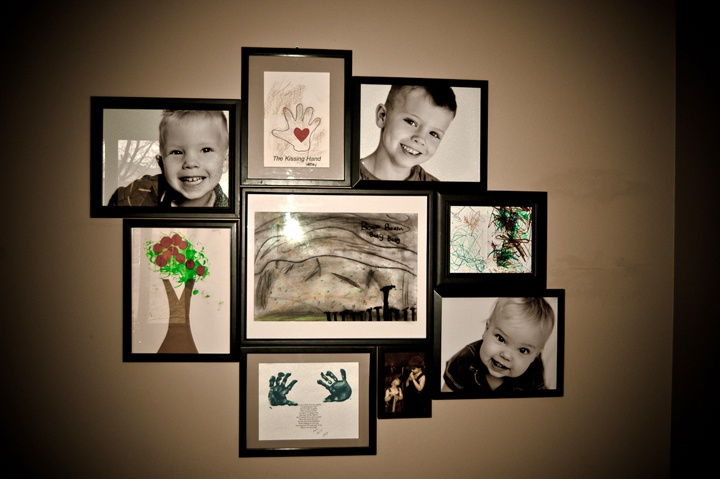Display children's artwork along with their current portraits. This is from my home and I used random black frames I had acquired over the years. This will eventually be featured on a more colorful wall...