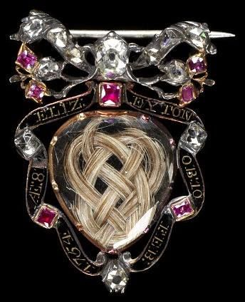 Mourning brooch, 1754, England. It was not uncommon in Georgian and Victorian times for bereaved relatives of the deceased to wear mourning jewelry containing locks of hair of their lost loved ones. With European examples dating as far back as the 15th century, the waves and patters created were often very intricate and added to the ornate appearance of the brooch, ring or necklace. These items of jewelry were worn as a memorial to the deceased and also as a reminder of our own mortality.