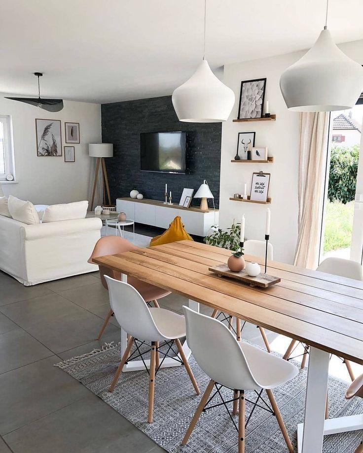 Sala da pranzo e soggiorno separati dai contrasti delle ...