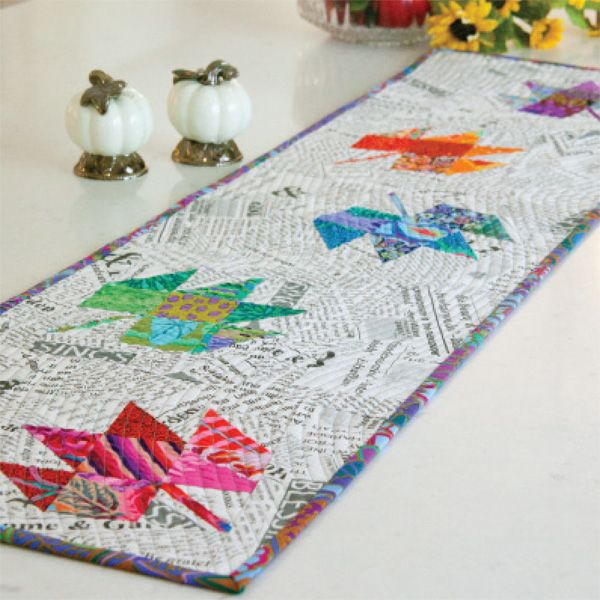 Pressed Leaves table runner by Tonya Alexander.  Made with Kaffe Fassett fabrics and text print.  McCalls Quilting September/October 2015.: