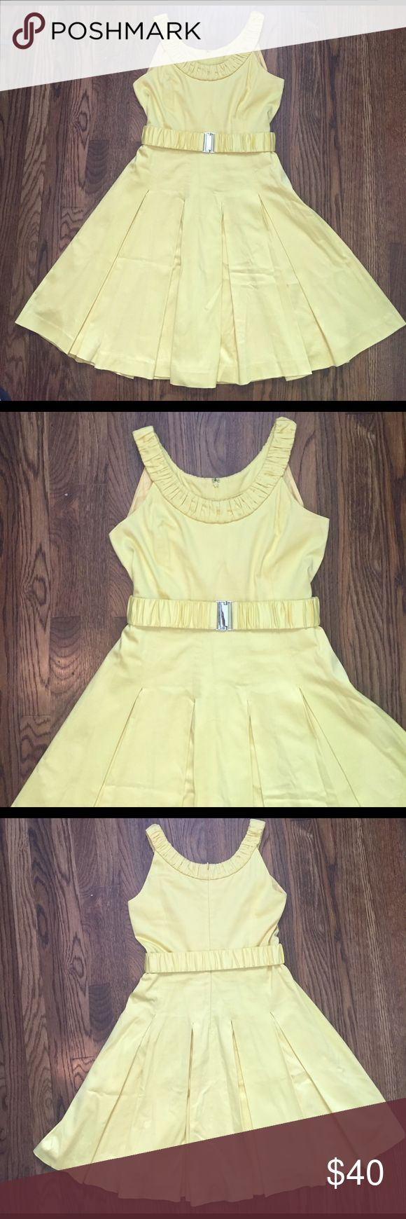 Calvin Klein Dress Perfect for Easter or a summer wedding! Heavy material, fully lined, inverted box pleat skirt. Really great condition, this is an excellent quality dress. One belt loop is unattached, pic included. I usually cut those off anyway, but left it in case you wanted to reattach it. Calvin Klein Dresses