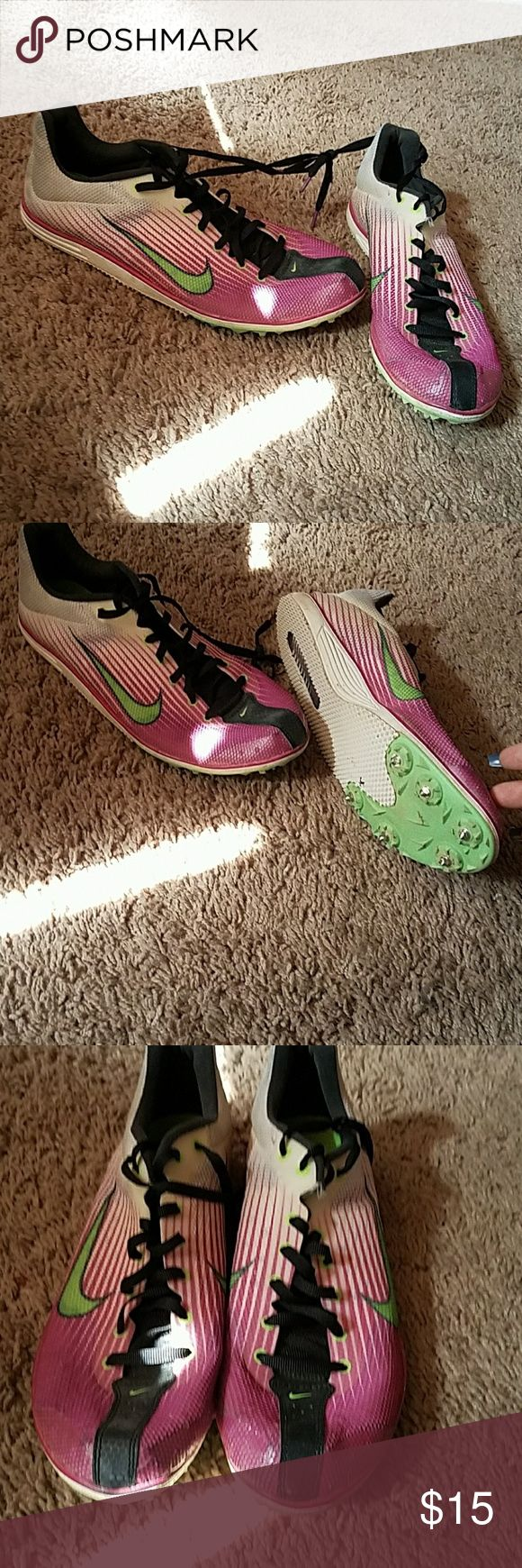 Track and field shoes/spikes Nike track and field shoes.  Spikes included a bit worn out. Nike Shoes Athletic Shoes