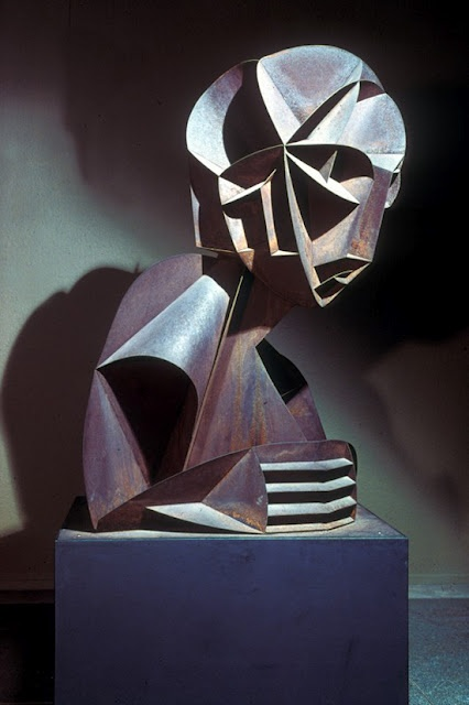 """Naum Gabo (1890-1977) was a pioneer of the Russian Constructivist art movement. His work utilized what is known as """"stereometric construction,"""" by which form is achieved through the description of space rather than mass. In explaining the method he once stated, """"We take four planes and we construct with them the same volume as four tons of mass."""" He felt his Head No. 2 sculpture created in 1916 (pictured below), was his first masterpiece and I would have to agree; the piece is mesmerizing."""