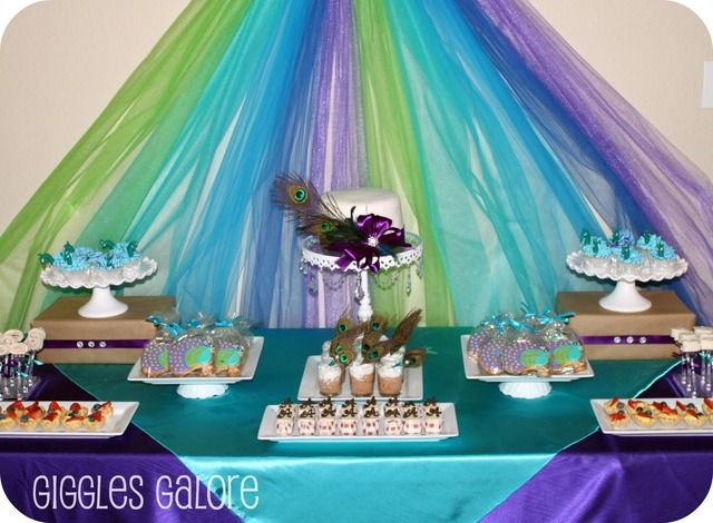 Table set-up ideas - maybe a little too extravagant for what I'm looking for with all the extra tulle in the backdrop, but i like the table display set-up