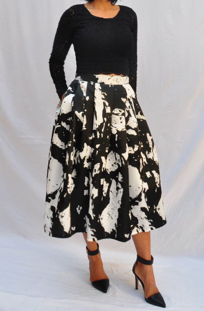 The Midi skirt is the latest skirt length this season. Cut from a gorgeous satin blend, the Paint Splash Midi is our hottest item on trend! Features an eye catching paint splash print, mid length cut, twin hip pockets, fully lined, and boxed pleats for a lady like silhouette. Measurements;Small: Waist 65cm; Length 75cmMedium: Waist 70cm; Length 75cm Large: Waist 75cm; Length 75cmSatin blend, fully linedTwin hip pocketsBoxed pleatsInvisible side zipMid length