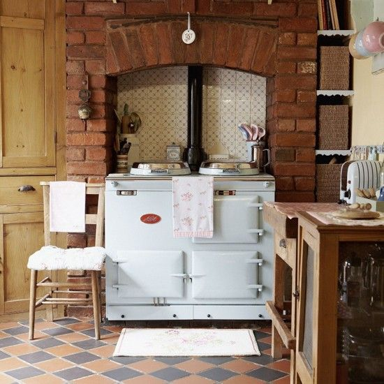 I've always dreamed of an Aga stove, and this brick recess sets it off beautifully.