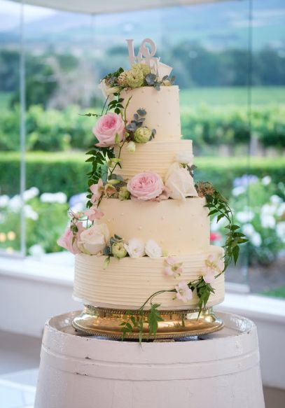 Wedding cake flowers by Flowers in the Foyer. Photo by Greg Lumley