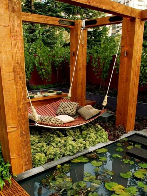 """I'd love to have this kind of hammock in my garden someday. I would make it much """"happier"""" though. More colors, twinkle lights and/or chinese lanterns, and higher, less contemporary, foliage would surround mine. ;]"""