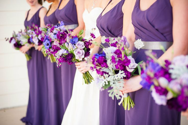 wedding bouquets in shades of purple include purple anemone, purple tulips, lavender roses, purple stock, purple lisianthus and dusty miller.