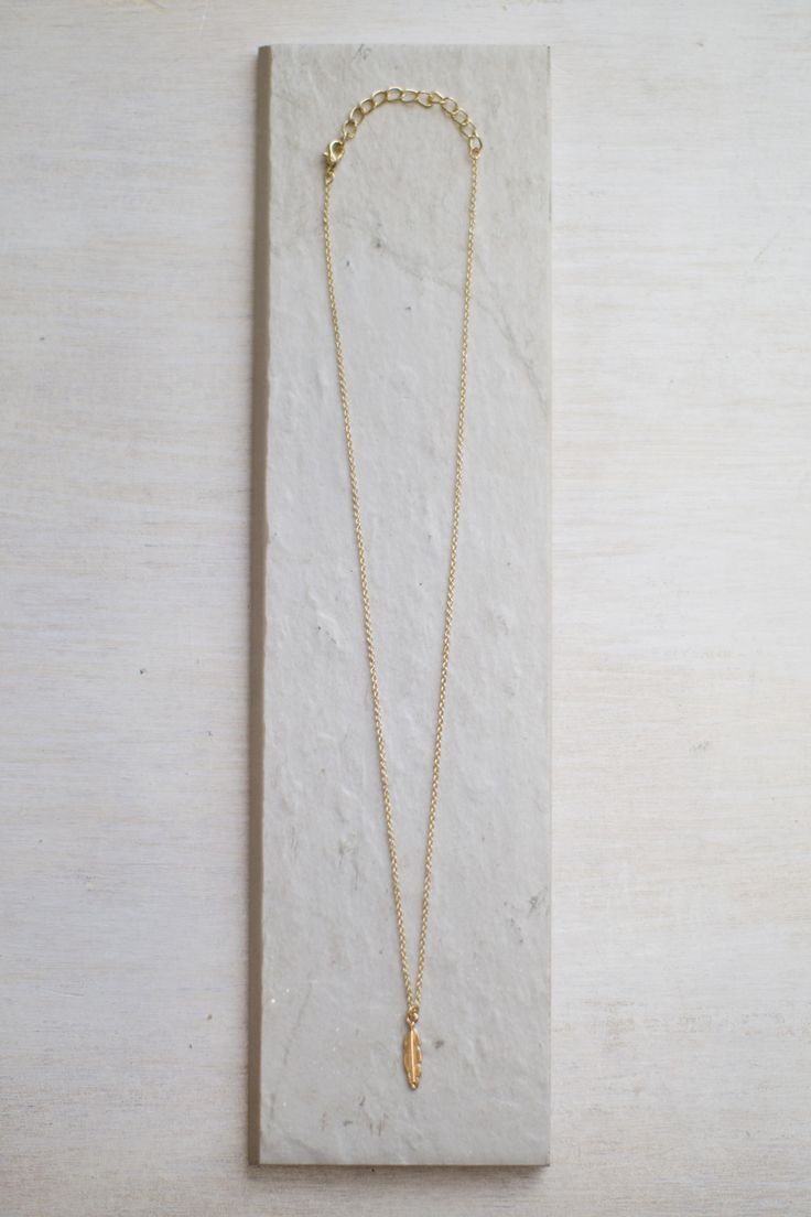 Light As A Feather Charm Necklace #shopmaude www.shopmaude.com