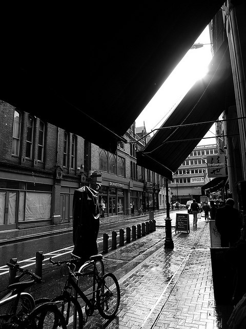 Downpour in Dublin by chad_k, via Flickr - taking shelter under the F awnings