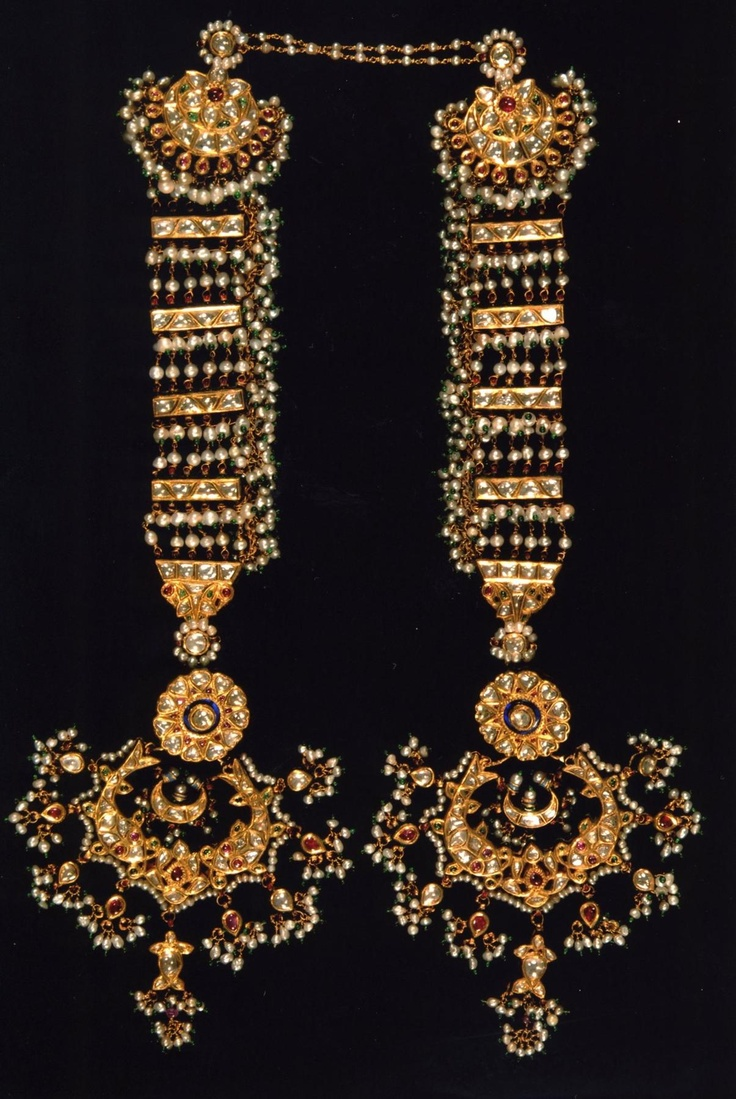 A traditional headornament set with diamonds. The reverse is decorated with safed chalwan enamelwork.  India, Rajasthan, ca 19th century
