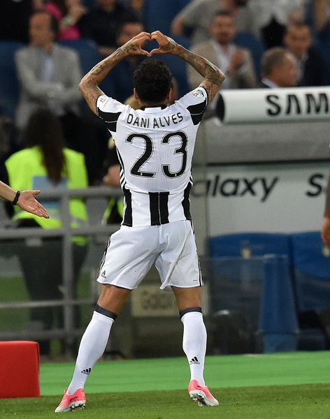 Daniel Alves Da Silva of Juventus FC celebrates after scoring the opening goal during the TIM Cup Final match between SS Lazio and Juventus FC at Olimpico Stadium on May 17, 2017 in Rome, Italy.