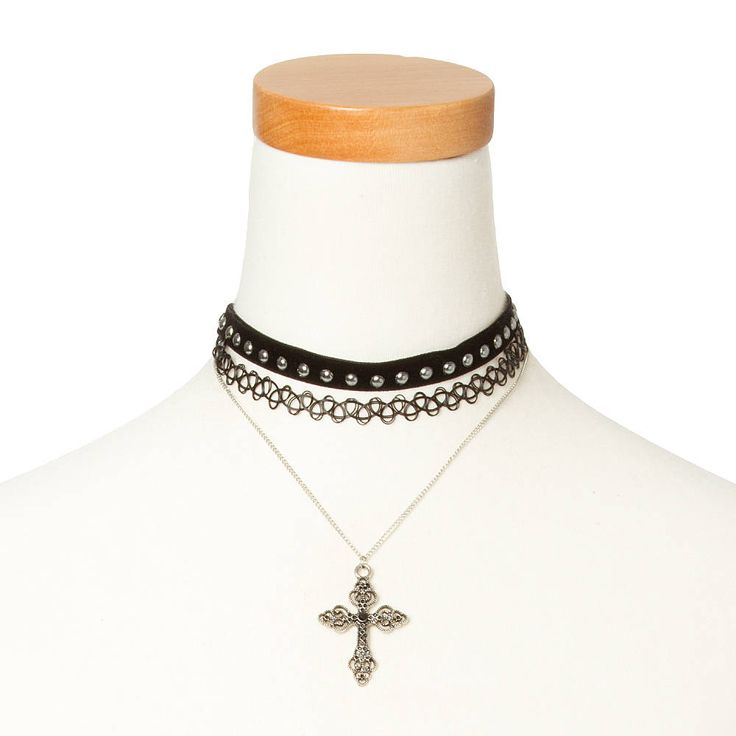 "<P>Show your faith in style with this cool choker and necklace set. Includes two black tattoo necklaces, one velvet choker with silver studs and one silver cross chain necklace.</P><UL><LI>Velvet and tattoo choker necklace with cross chain necklace.<LI>Chokers: 6""L<LI>Chain: 11""L<LI>Materials: Velvet/Silver metal finish</LI></UL>"