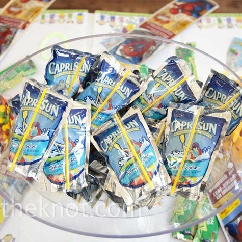 One reception table -- set at the right height for smaller guests -- was set with a spread of treats for the younger guests, including stickers, crayons, snacks, and candy....love this idea!