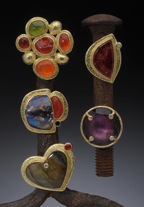 Assorted Standing Rings Top left, clockwise: 18K Mexican fire opal and peridot, 18K pink tourmaline and white diamond, 18K faceted amethyst, 18K labradorite and red spinel, 18K boulder and Mexican fire opal. Hughes-Bosca Jewelry | Rings