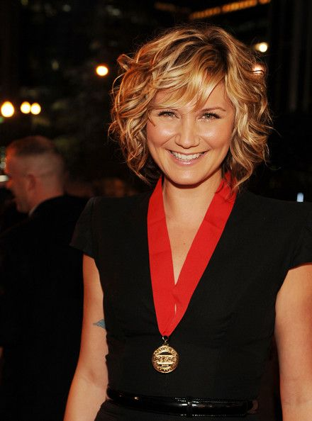 Jennifer Nettles on stylebistro.com.  Similar to the Charlize Theron style - but with cute bangs.