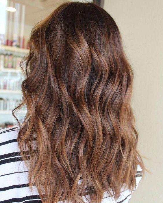 Glamorous red hair color on medium wavy hair
